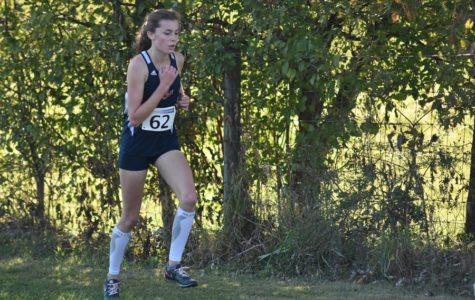 Freshman Kate Kirwan runs the Girls Varsity Race at the Regional meet. Kirwan placed 23rd out of 65 runners.