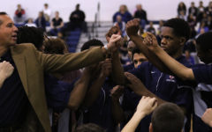 The Streaks huddle during a timeout as head coach Don Burgess speaks.