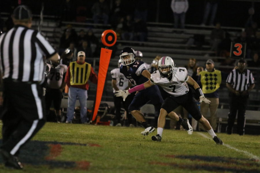 Senior Gabe Poirot sprints down the field to defend a punt.