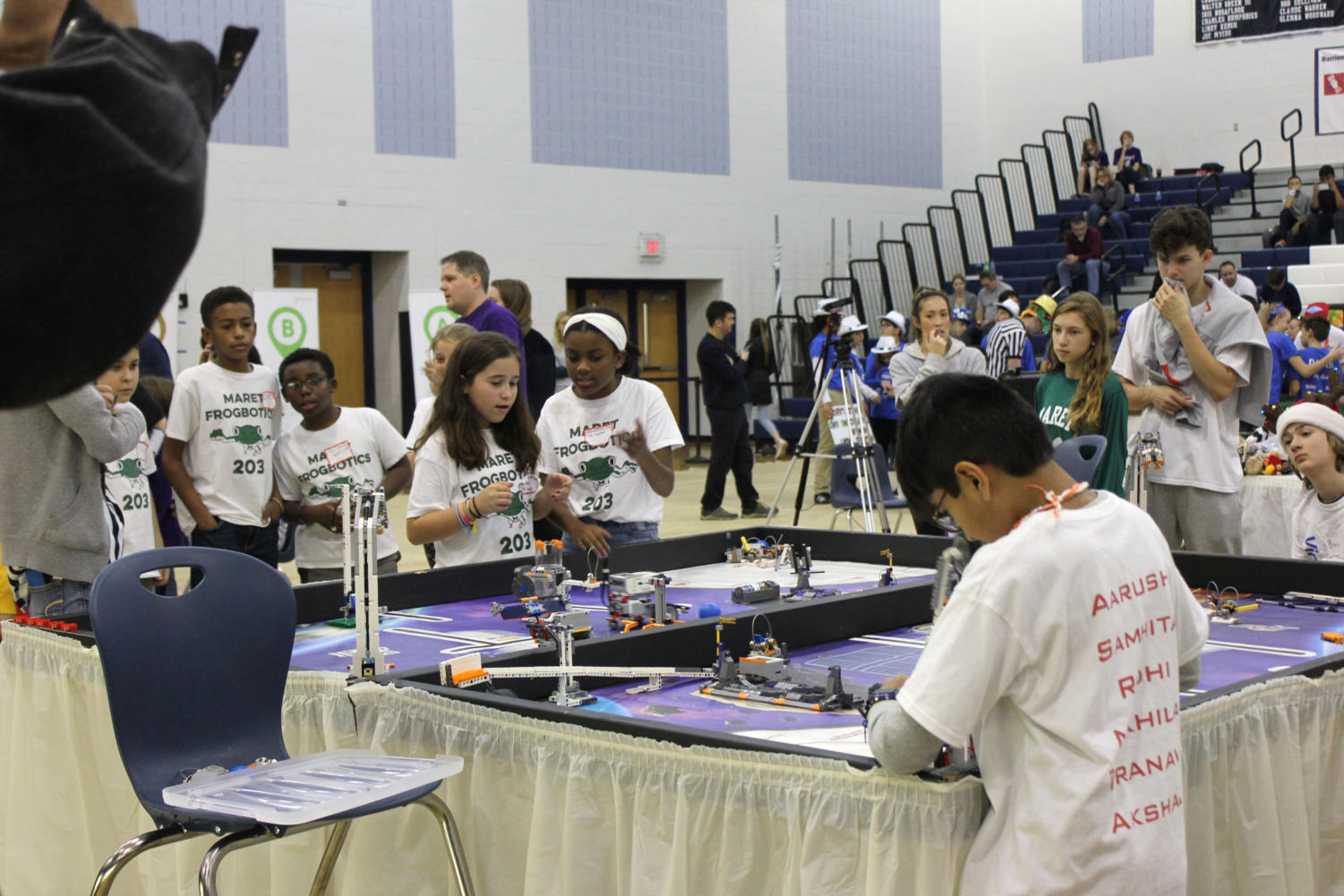 Elementary and middle school students take part in the LEGO tournament.