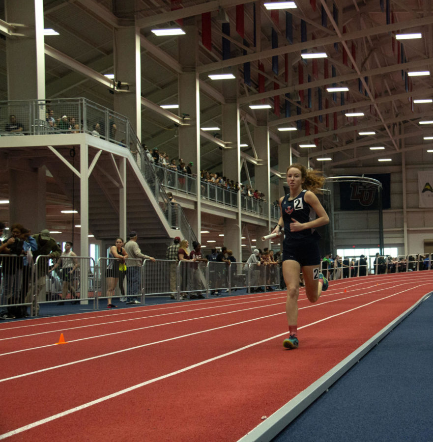 Senior+Hannah+Miller+runs+the+4x800+relay+with+freshman+Kate+Kirwan%2C+sophomore+Mia+Constantin+and+junior+Sarah+Deloney.
