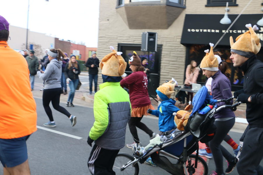 A family starts their second lap of the race, dressed in matching attire.
