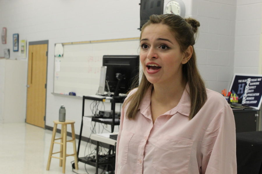 Junior Gia Yoder rehearses a piece in the choir room before auditioning for this year's musical, Legally Blonde.