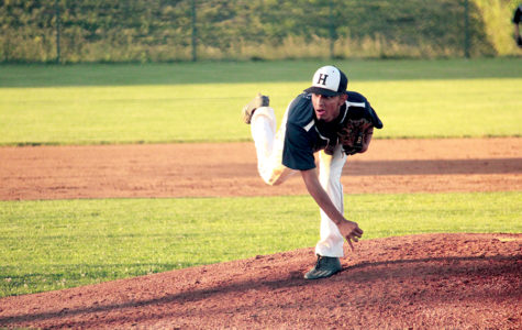 Jose Rocha throws a fastball down to a batter in the Regional semi-finals during his sophomore year. The game went to the tenth inning and ended with the Streaks having a walk win. The final score of 14-13 sent the Streaks to the state tournament.