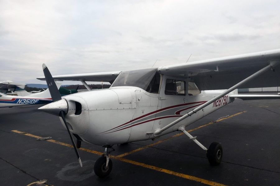 The+Cessna+172+Skyhawk+that+Phillips+flies+sits+at+an+airfield.+