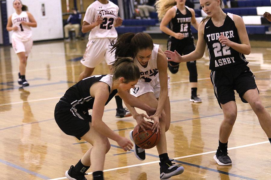Freshman Mariah Cain scrambles for a loose ball.