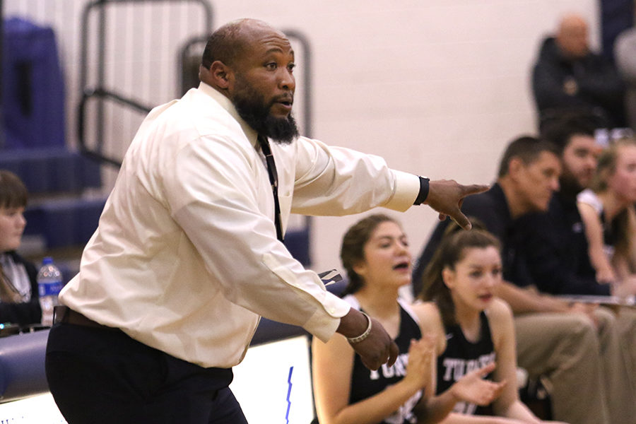 Coach Durmount Perry yells to the team.