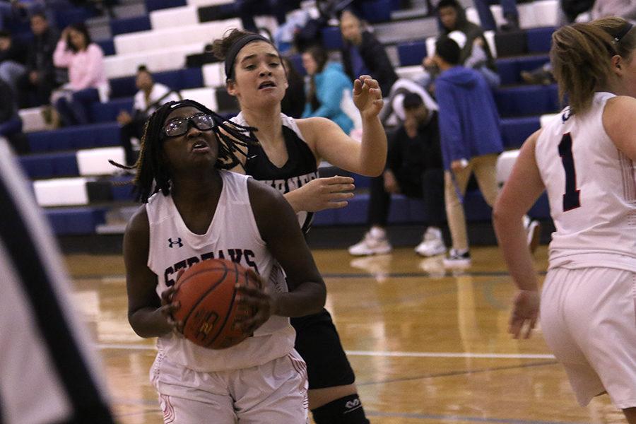 Junior Atilia Thomas goes up to the basket.