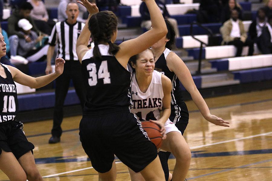 Freshman Mariah Cain goes up to the basket.