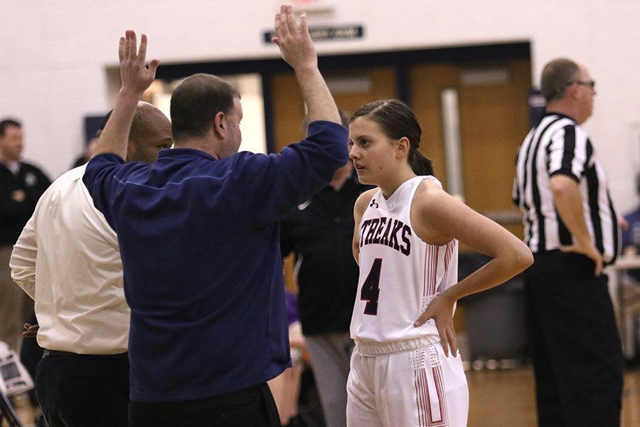 Coach Mark Neofotis talks to freshman Elizabeth Muncy during the game.