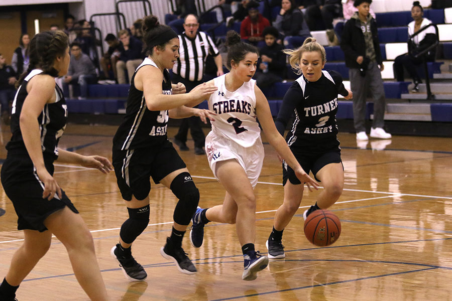 Junior Jane Thompson is double teamed by the Knights.