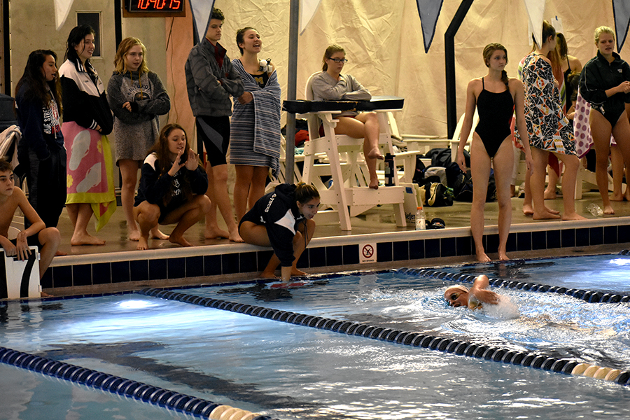 Juniors+Grace+Gabriele+and+Luna+Fulgueiro-Fuchs+and+freshman+Luz+Fulgueiro-Fuchs+cheer+for+sophomore+Lizzy+Wyatt+as+she+goes+into+her+last+25+yards+of+the+500+Freestyle.+