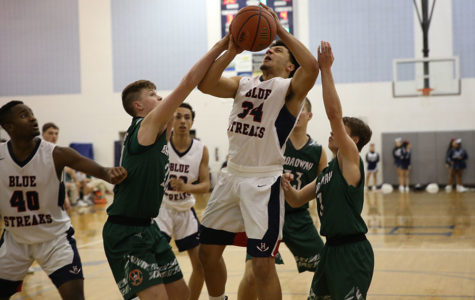 Varsity boys basketball falls to Broadway, 80-74