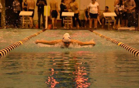 Swim team breaks two school records in Ben Hair swim meet