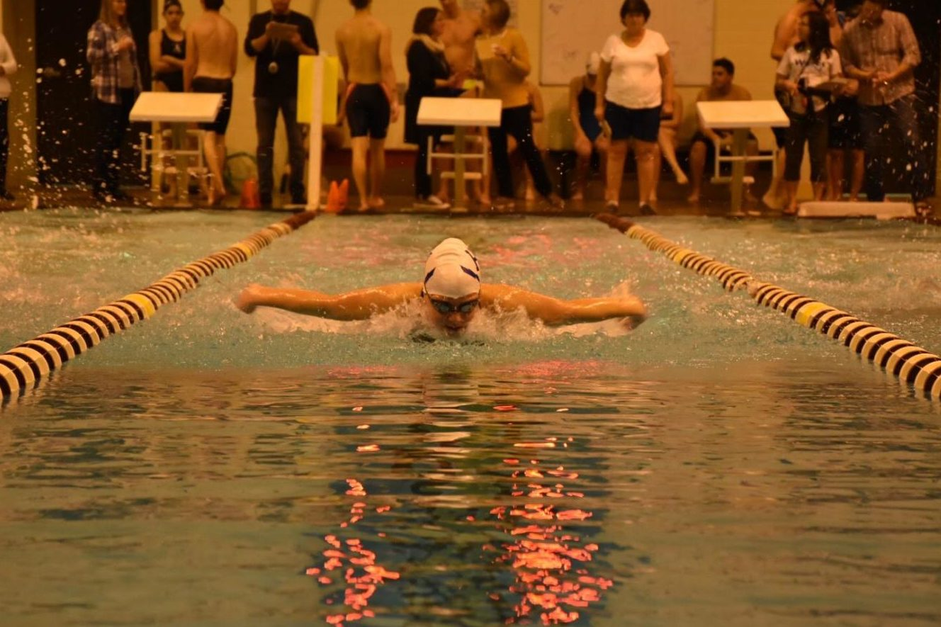 Freshman Maddie McCay swims butterfly during the season opener vs. Turner Ashby. Since, McCay broke the school record for the 100 fly at the Ben Hair Invitational.