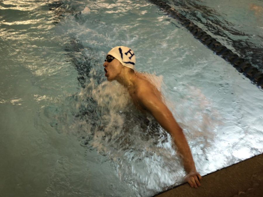 Senior William Daniel does his final turn going into the last length of the 100 butterfly.