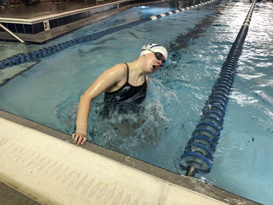 Sophomore Emma Lankford does her turn going into the second lap of her 100 breaststroke.
