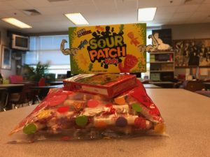 Sour Patch Kids stands triumphantly over other candies.