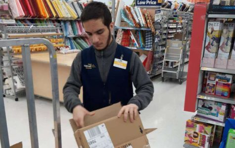 Senior Pana Muhamad breaks down boxes while working the floor at Walmart.