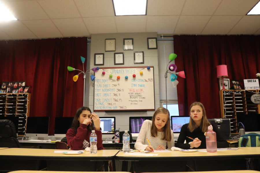 Soraya Kaussler, Anne Poirot and Clare Kirwan contemplate and write down the flavors they taste from pizza option one.