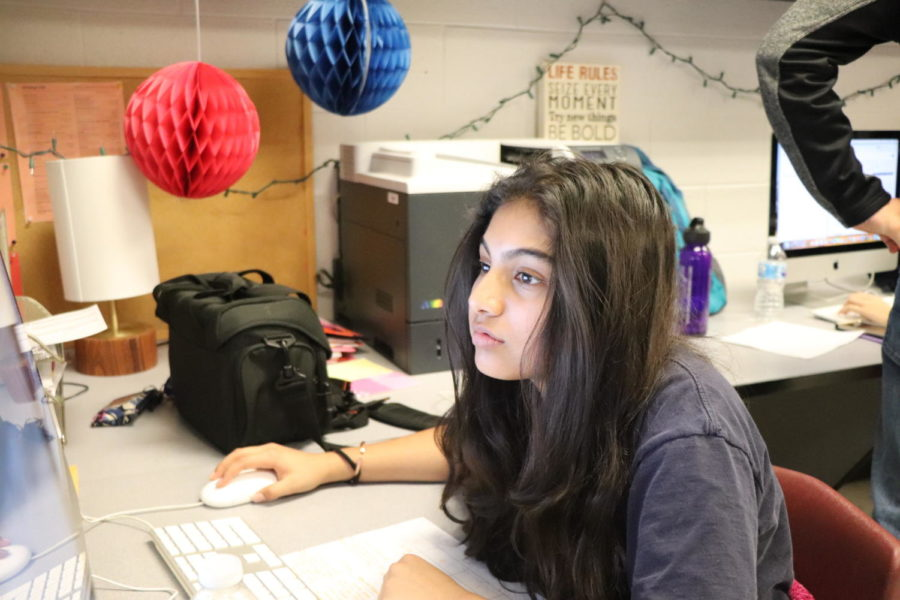 Imaan Shakoor searches through HHS Media looking for examples on how to write her bio.