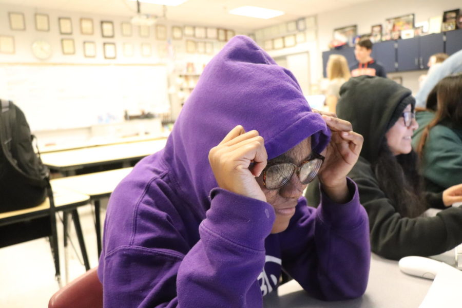 Kamari Robinson hides under her hoodie as she stresses about wrting her bio.