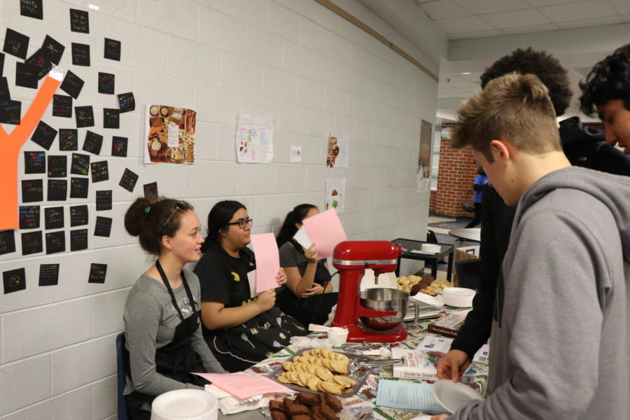 Students from the cooking class showcase their product.