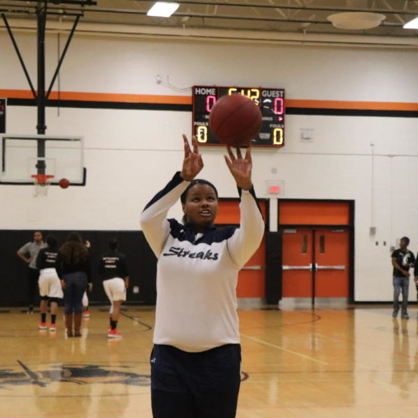 Sophomore Nisha Farmer shoots a free throw during warmups prior to the Streaks game.