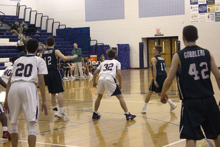 Freshman Dylan Burnette prepares to defend against an opposing player.