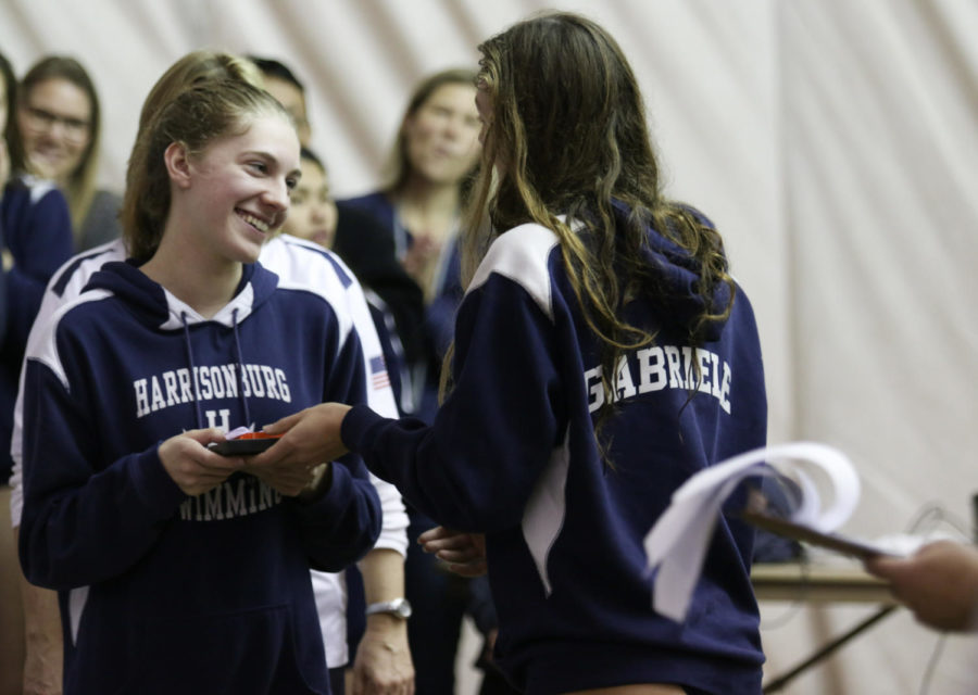 Junior Grace Gabriele (right) recognizes senior Andi Fox with a gift.