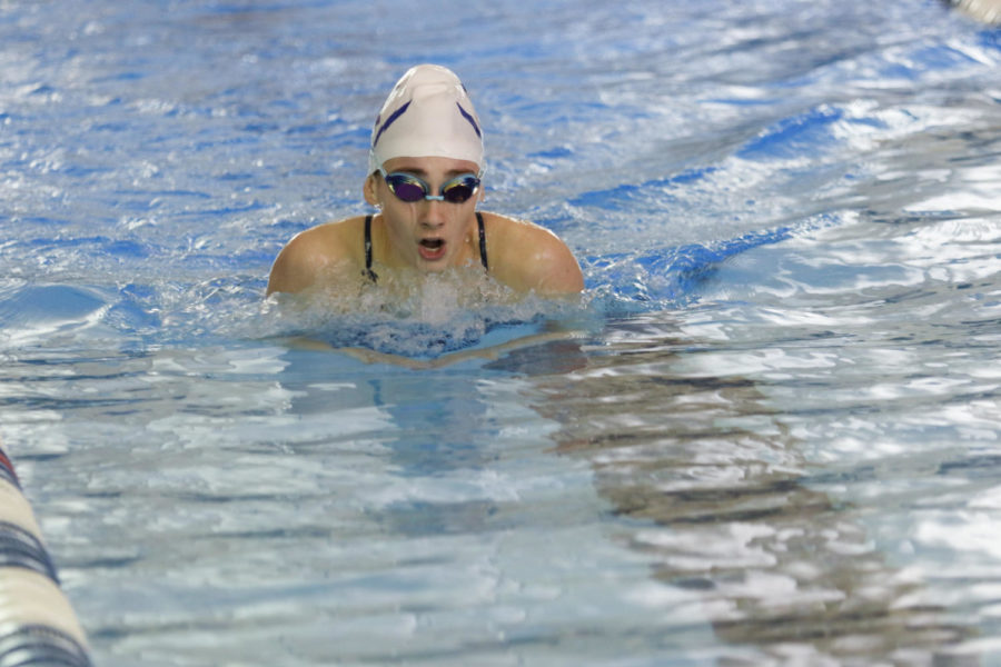 Junior Lily Gusler swims the breakstroke portion of the 200 Individual Medley event. It consists of a 50 of butterfly, backstroke, breakstroke and freestyle.