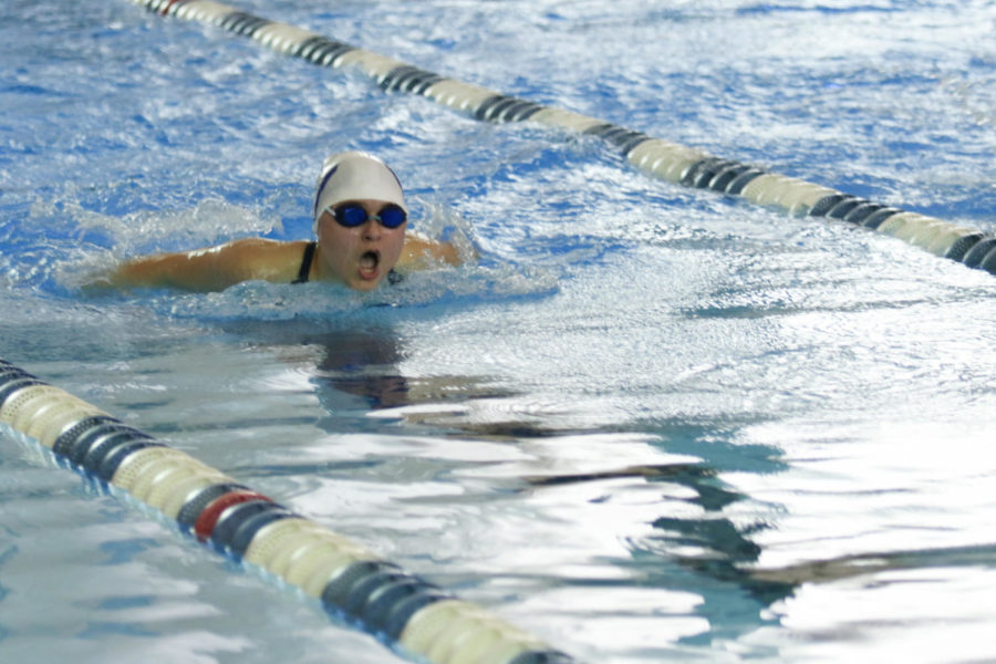 Sophomore Stella Alexiou takes a breath during her 100 butterfly swim.