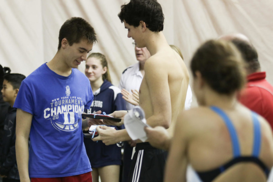 Junior Ritt Culbreth (right) presents senior William Daniel with a gift during the senior recognition.
