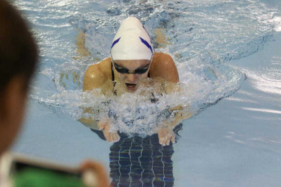 Junior Grace Gabriele participates in the 100 yard breaststroke event.