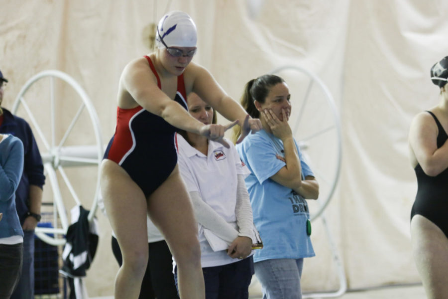 Senior Christa cole prepares to dive in after her team mates touches the wall during a relay event.