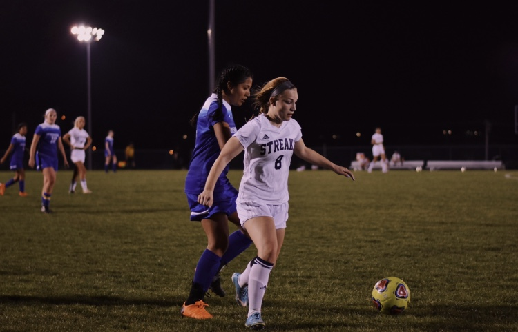 Senior+Mikaela+O%27Fallon+wins+the+ball+during+a+game+in+her+junior+season.+After+tearing+her+ACL+three+times%2C+O%27Fallon+was+able+to+return+to+soccer+each+time+and+recently+committed+to+continue+her+career+at+the+University+of+Mary+Washington.