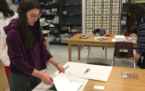 Senior Julia Inouye works in the combined Art 4 and AP Art class. Seniors may take either class depending on their desired workload.