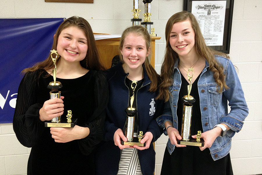 Sophomore Stella Alexiou, sophomore Emma Lankford and freshman Kate Kirwan won trophies at Tournament of Champions, a smaller tournament that took place a few weeks before regionals.