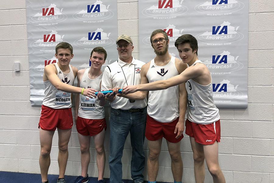 From left: The boys 4x800 meter relay consists of junior Tucker McGrath, sophomore Hayden Kirwan, senior Alex Hulleman and sophomore David Beck. Coach Jerry Hertzler is in the middle.