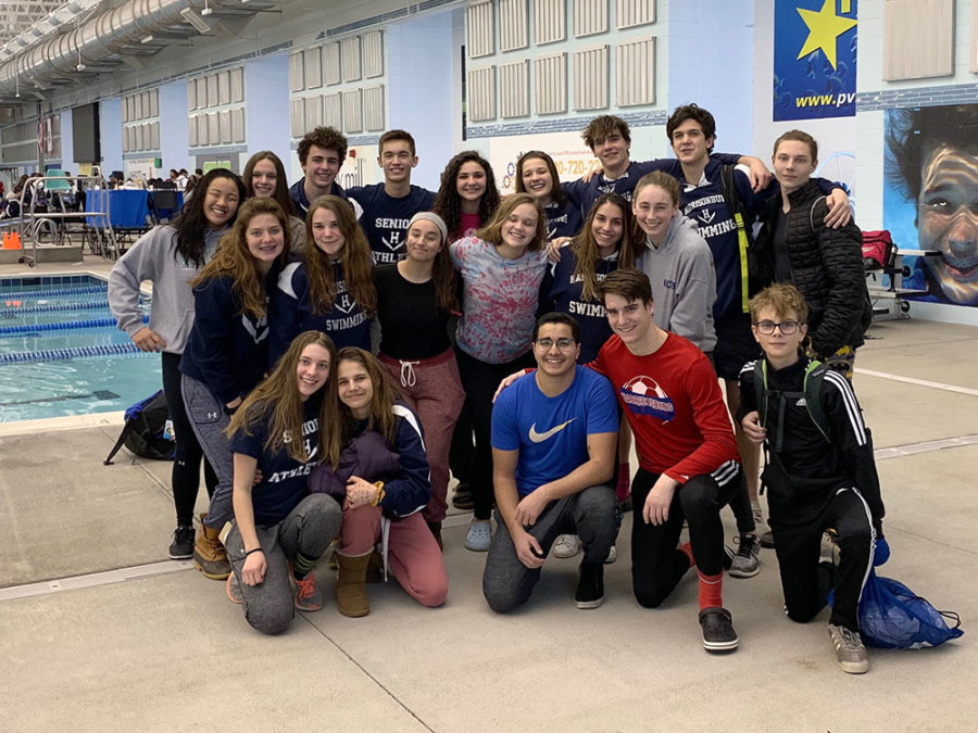 The+swim+teams+gathers+together+for+one+last+group+picture.+Although+the+season+is+over+for+most+of+the+teams%2C+five+swimmers+will+be+moving+on+to+the+state+meet+Feb.+14-16+at+George+Mason.