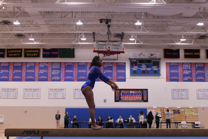 Sophomore+Dorothy+Yates+gets+ready+to+do+a+tuck+jump+on+beam.