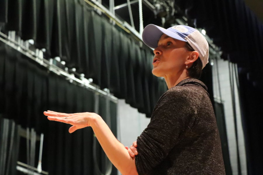 Dance teacher Amber Corriston shows the cast where they're supposed to be before starting rehearsal.