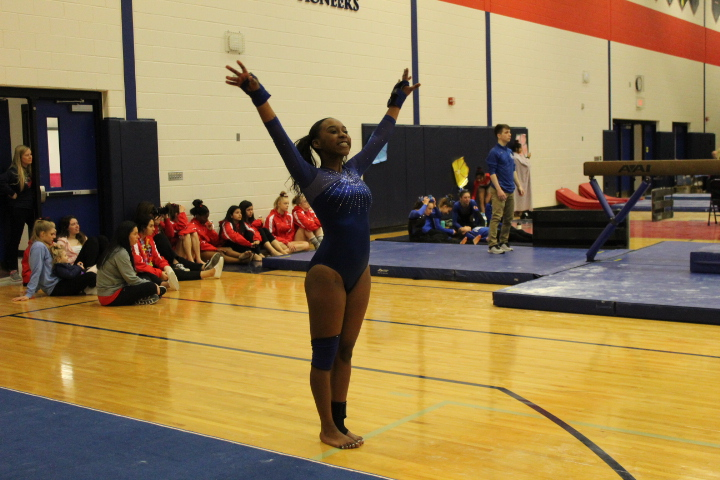 Sophomore+Dorothy+Yates+salutes+to+the+judges+before+competing+on+vault.+