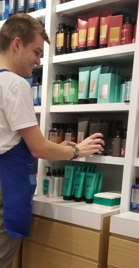 Family and Consumer Sciences teacher Nicholas Zimmerman restocks the shelves during his shift at Bath & Body Works. Zimmerman decided to take on a second job for extra spending money.