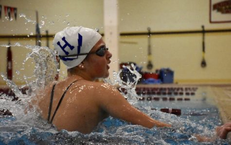 McCay finds success in freshman swim season, breaks school records