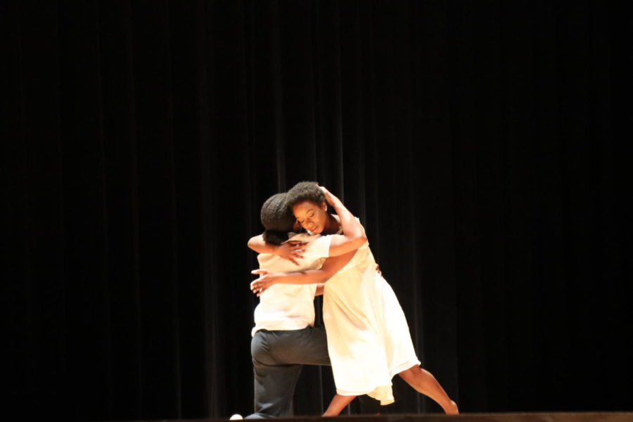 Two dancers embrace.
