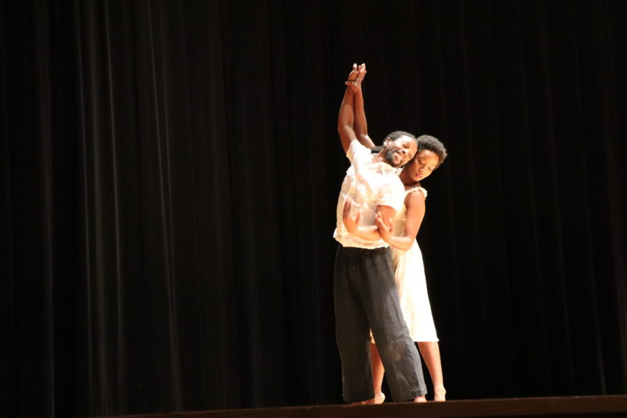 Two of the dancers move in unison.