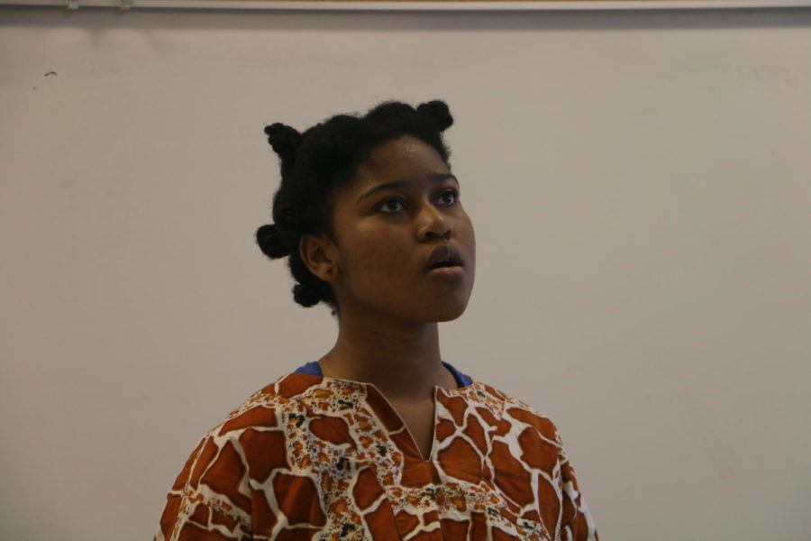 Senior Ivana-Mensah Agekum recites her poem during practice before an upcoming competition. Mensah-Agekum recently placed first in the Poetry Out Loud Regional Competition.