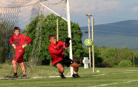 Sophomore Jaiden Brooks plays goalkeeper during a game in the 2017-2018 soccer season. Outside of playing for the Streaks, Brooks also plays for Soccer Organization Charlottesville Area (SOCA) and Shenandoah Valley United (SVU).