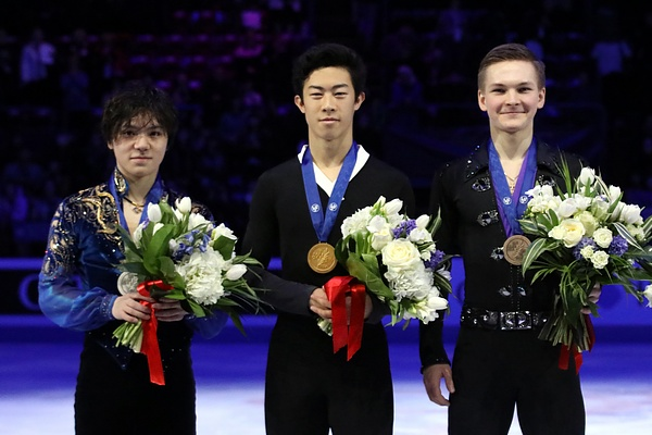 Nathan Chen, center, receives his medal at the 2018 World Championships Podium. Chen is the youngest U.S. male skater to win the Grand Prix of Figure Skating Final.